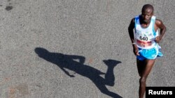 FILE - The shadow of runner is seen in the Nairobi Marathon.