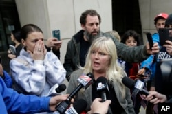 Defendant Shawna Cox speaks outside federal court in Portland, Ore., Oct. 27, 2016. A jury exonerated brothers Ammon and Ryan Bundy and five others of conspiring to impede federal workers from their jobs at the Malheur National Wildlife Refuge.