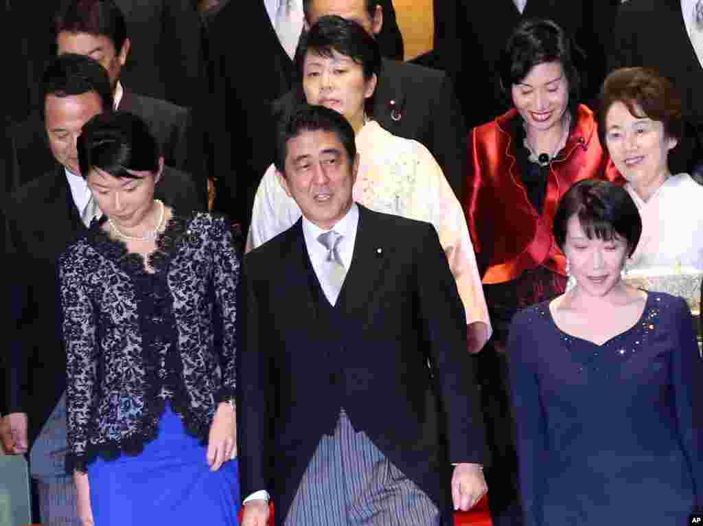 Japan's Prime Minister Shinzo Abe (front row center) and his new cabinet members gather for a photo session following the first cabinet meeting at the prime minister's official residence in Tokyo, Sept. 3, 2014.