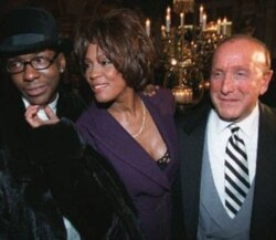 Whitney Houston, husband Bobby Brown, left, and Clive Davis, president and founder of Arista Records, in New York City in 1998