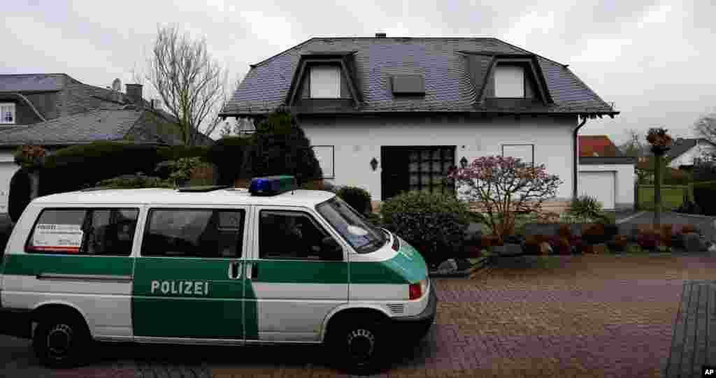 A police car waits in front of the family house of Andreas Lubitz, co-pilot of the Germanwings plane that crashed in the Alps, in Montabaur, Germany, March 27, 2015.