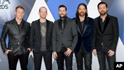 FILE - Members of Old Dominion, from left, Trevor Rosen, Whit Sellers, Matthew Ramsey, Geoff Sprung and Brad Tursi arrive at the 49th annual CMA Awards at in Nashville, Tennessee, Nov. 4, 2015.