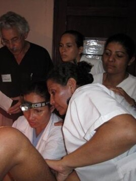 Dr. Art Levit, (left) a PINCC volunteer, supervises doctors during an examination in Jalapa, Nicaragua.