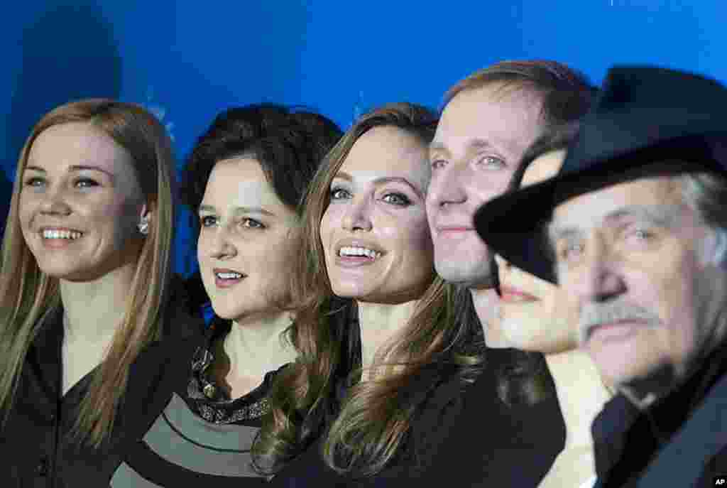 "Actors Alma Terzic, Vanesa Glodjo, director Angelina Jolie, actors Goran Kostic, Zana Marjanovic and Rade Srbedzija, from left, pose for the photo call of the film ""In the Land of Blood and Honey"" in Berlin, February 11, 2012. (AP)"