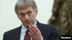 Spokesman Dmitry Peskov gestures at the Kremlin in Moscow, Russia, March 26, 2018.