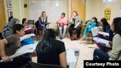 A discussion group at Women for Afghan Women headquarters in Queens, New York. (Credit: WAW)