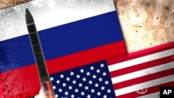 Foto drapo Larisi ak Etazini, bò kote yon misil defans ameriken.