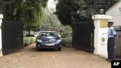 A Kenyan policeman stands outside the charge d'affaires residence in Runda estate in Nairobi, Kenya, July 27, 2012. The acting Venezuelan envoy to Kenya was dead Friday at the official residence, police said.
