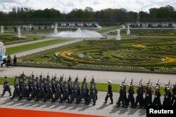 Guard of honor arrives before the welcome ceremony of U.S. President Barack Obama at Schloss Herrenhausen in Hanover, Germany, April 24, 2016.