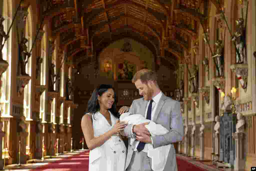 Britain's Prince Harry and Meghan, Duchess of Sussex, during a photocall with their newborn son, Archie, in St. George's Hall at Windsor Castle, Windsor, England.