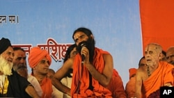 Renowned yoga guru Baba Ramdev, center, speaks during his hunger strike against corruption in New Delhi, India, June 4, 2011