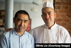 Bakir Osman (left), manager, and Ekber Kayser, chef and owner, stand together inside Dolan Uyghur Restaurant in Washington, D.C.