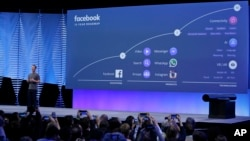 FILE- In this April 12, 2016, file photo, Facebook CEO Mark Zuckerberg talks about the company's 10-year roadmap during the keynote address at the F8 Facebook Developer Conference in San Francisco.