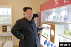 FILE PHOTO: North Korean leader Kim Jong Un visits a cosmetics factory in this undated photo released by North Korea's Korean Central News Agency (KCNA) in Pyongyang on October 28, 2017.