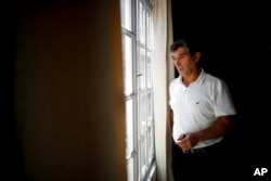 Claudio Rojas, a 55-year-old handyman who was deported from the U.S. in 2019, is pictured in his home in Moreno, Argentina, May 8, 2021. His wife, two sons and two grandsons remained in Florida.