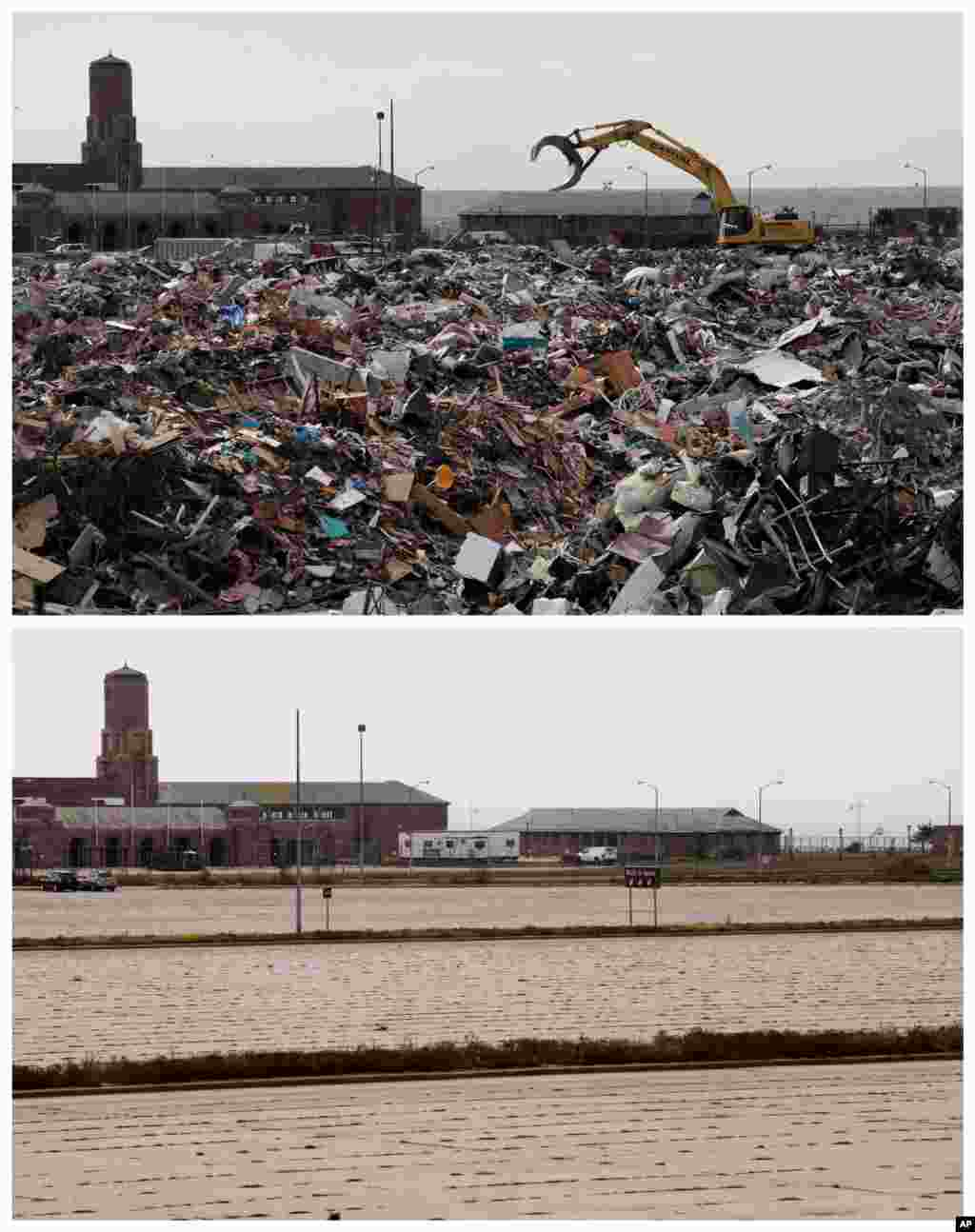 This combination of Nov. 14, 2012 and Oct. 17, 2013 photos shows construction equipment working on debris collected during the cleanup from Superstorm Sandy in the parking lot of Jacob Riis Park in the Rockaway section of New York.
