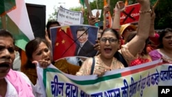 Activists shout slogans against China during a protest in New Delhi July 4, 2017. The protest was over China's decision to suspend pilgrimages to a sacred site in Tibet following tension between Indian and Chinese troops along the India-China border.