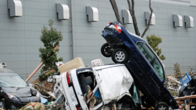 Cars upended and destroyed by the tsunami that struck Miyagi Prefecture following Friday's 8.9 magnitude earthquake in Sendai, Japan, March 14, 2011.