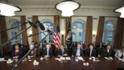 President Obama with aides and cabinet members in the White House Cabinet Room Thursday