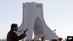 Iranian President Mahmoud Ahmadinejad gestures as he deliver his speech near the Azadi (freedom) tower at a rally to mark the 33rd anniversary of the Islamic Revolution that toppled the country's pro-Western monarchy and brought Islamic clerics to power,