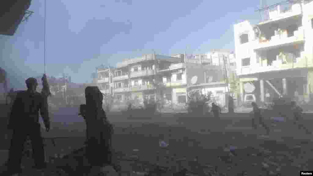 Homs şəhəri qumbara atəşlərinə məruz qalıb - 9 fevral, 2014