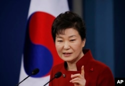 FILE - South Korean President Park Geun-hye answers to a reporter's question during her news conference at the Presidential Blue House in Seoul, South Korea, Jan. 13, 2016.