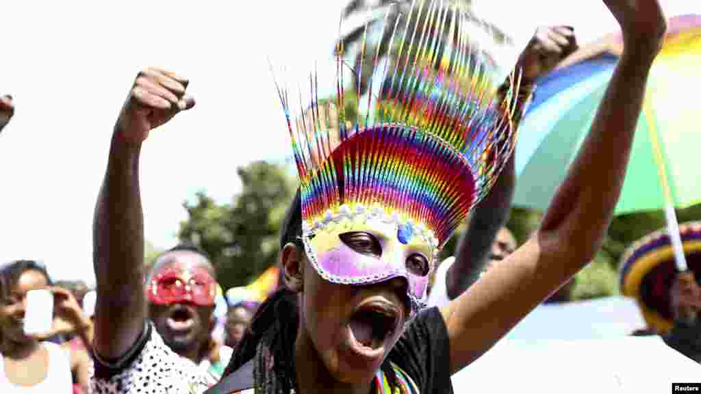 People walk in a parade as they celebrate the annulment of an anti-homosexuality law by Uganda's constitutional court in Entebbe, Aug. 9, 2014.