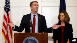 FILE - Virginia Gov. Ralph Northam, left, gestures as his wife, Pam, listens during a press conference in the Governor's Mansion at the Capitol in Richmond, Virginia, Feb. 2, 2019.
