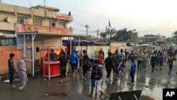 Hiện trường vụ đánh bom kép ở thành phố Sadr ngày 28/2/2016.