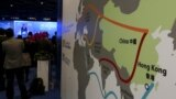 """FILE - A map illustrating China's silk road economic belt and the 21st century maritime silk road, or the so-called """"One Belt, One Road"""" megaproject, is displayed at the Asian Financial Forum in Hong Kong, China."""