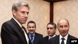 Ambassador Christopher Stevens, left, shook hands with Libyan National Transitional Council chairman Mustafa Abdel Jalil after a meeting in Tripoli on June 7