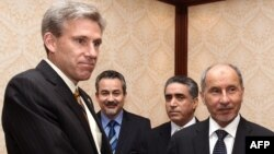 US ambassador to Libya, J. Christopher Stevens (L), shaking hands with Libyan National Transitional Council (NTC) chairman Mustafa Abdel Jalil (R) after presenting his credentials during a meeting in Tripoli, June 7, 2012.