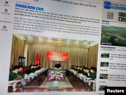 A state media article from March 17, 2021 with a picture of a meeting marking five years since the creation of Vietnam's 'Force 47' cyber army is displayed on screen in this picture takenJuly 8, 2021. (TRUYENHINHNGHEAN.VN via REUTERS)