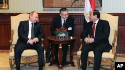 FILE - Egyptian President Abdel-Fattah el-Sissi, right, talks to Russian President Vladimir Putin during their meeting in Cairo, Egypt, Feb. 9, 2015.