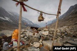 A Hindu holy man meditates near the Gangotri Glacier at an altitude of 4000 meters in the northern Indian state of Uttarakhand, May 11, 2019.