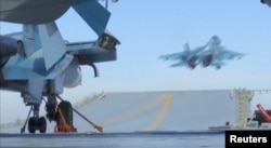 A still image taken from a video footage and released by Russia's Defense Ministry on Nov. 15, 2016, shows a jet taking off from Russian Admiral Kuznetsov aircraft carrier near the coast of Syria.