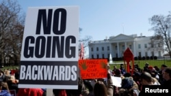 Protesters demonstrate against U.S. President Donald Trump outside the White House in Washington, March 23, 2017.
