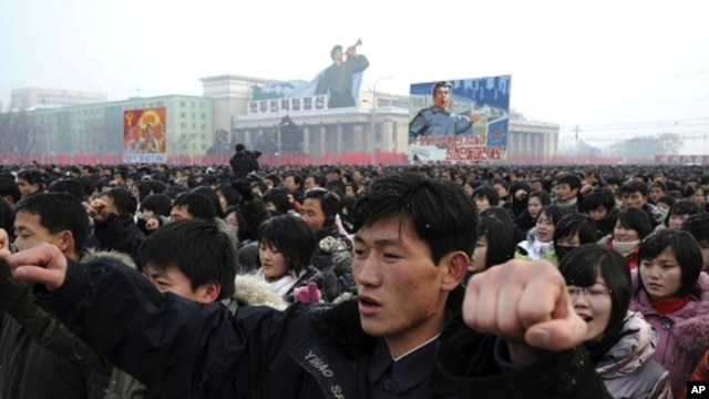 Thousands of North Koreans gather in Pyongyang at Kim Il Sung square to hold a mass rally in support for their country's policies and new leader Kim Jong Un, January 3, 2012.