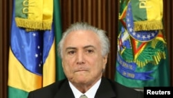FILE - Brazil's interim President Michel Temer reacts during a meeting of the presentation of economic measures, at the Planalto Palace in Brasilia, Brazil, May 24, 2016.