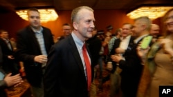 Alaska Republican Dan Sullivan says he has defeated Democrat Dan Sullivan in a bid for the U.S. Senate. He's shown at an election party in Anchorage Nov. 4, 2014.
