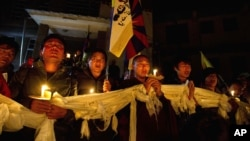Exile Tibetans participate in a candlelit vigil Dharmsala, India, to express solidarity with a young Tibetan Dorjee Lhundrup who allegedly immolated himself in protest against Chinese rule, November 4, 2012.