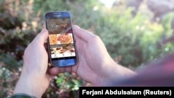 FILE - The Yummy app, a homemade food ordering service in Libya.