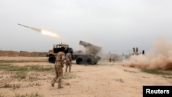 FILE - Iraqi soldiers fire a rocket toward Islamic State militants on the outskirts of Makhmour south of Mosul, Iraq, March 25, 2016. Iraq's security forces have announced the start of an operation to retake control of Ar-Rutbah, a town in western Anbar province.