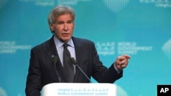 """American actor Harrison Ford speaks about ocean conservation at the World Government Summit in Dubai, UAE, Feb. 12, 2019. Ford offered an emphatic plea for protecting the world's oceans while calling out U.S. President Donald Trump and others who """"deny or denigrate science."""""""