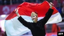 Sugianto merayakan kemenangan setelah meraih medali emas nomor seni perorangan putra di Asian Games 2018, Jakarta, 29 Agustus 2018.
