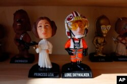 """Bobbleheads from the """"Star Wars"""" movies are displayed at National Bobblehead Hall of Fame and Museum in Milwaukee. (AP Photo/Carrie Antlfinger)"""