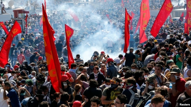 Riot police use tear gas to disperse demonstrators during an anti-government protest at Taksim Square in central Istanbul, Turkey, June 1, 2013.