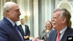 John Bolton, US National Security Advisor, right, is welcomed by Belarusian President Alexander Lukashenko during their meeting in Minsk, Belarus, Thursday, Aug. 29, 2019.