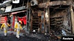 이라크 바그다드에서 18일 발생한 폭탄 테러 현장.