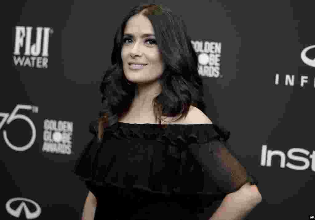 """演员萨尔玛·哈耶克参加在加利福尼亚州西好莱坞举行的2018年金球奖会议(2017年11月15日)。哈耶克投书报纸,讲述她2002年主演传记影片""""弗里达""""时拒绝电影大亨哈维·温斯坦的进逼导致的一场噩梦般的经历 。哈耶克在12月13日""""纽约时报""""发表的的文章说,温斯坦多年来一直是""""我的妖怪"""",温斯坦会在""""夜晚的种种时间,在一家酒店又一家酒店,一个地方又一个地方""""出现在她门前。"""